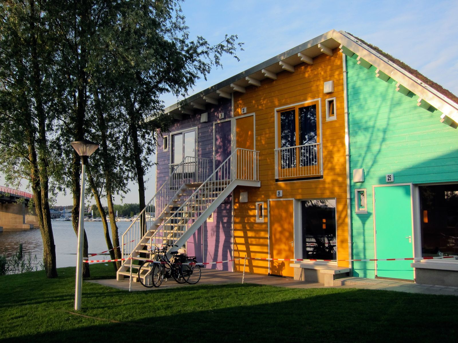 2 x four-person eco cabins next to each other on the waterfront