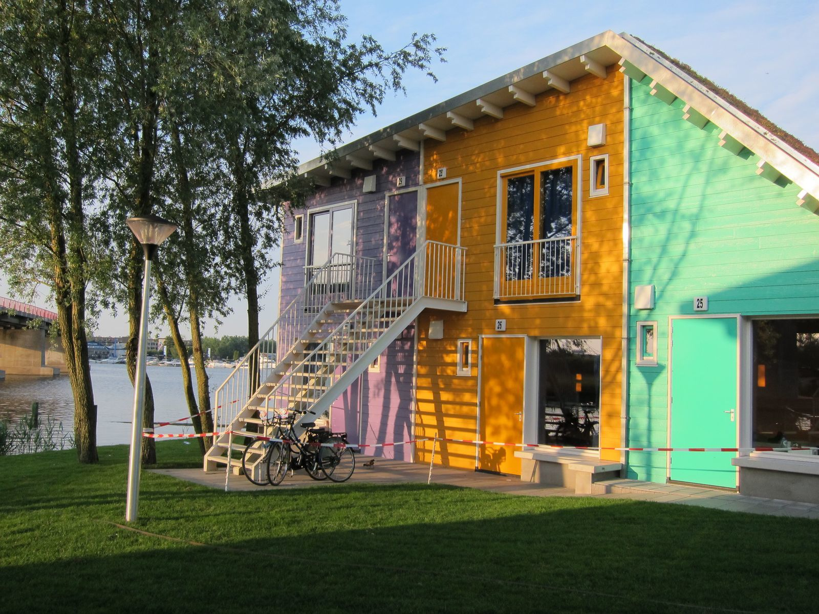 A two-person and a four-person Eco Cabin next to each other on the waterfront